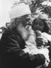 Informal picture of 'Abdu'l-Baha with Pauline Morse in His arms, Green Acre, USA, August 1912. Courtesy of http://media.bahai.org/.